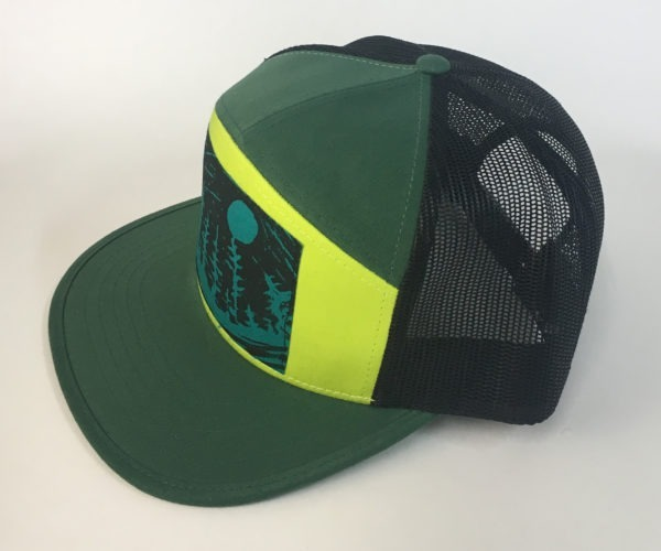 Side view of Green 7 Panel NW Night Print hat