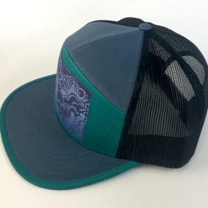Side view of Ocean Blue and Teal 7 Panel with Head in the Clouds print hat